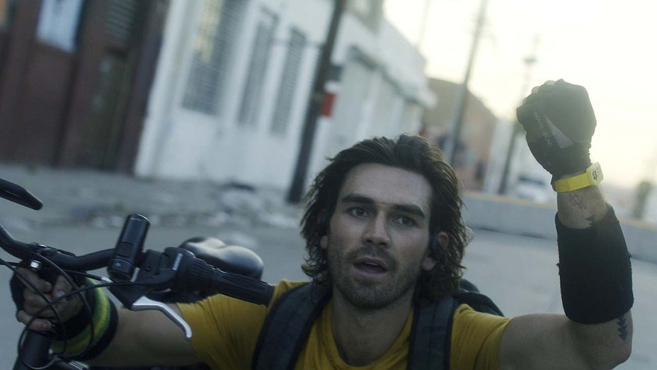 KJ Apa as the heroic bike messenger who is immune to the mutated COVID disease as seen in Songbird.