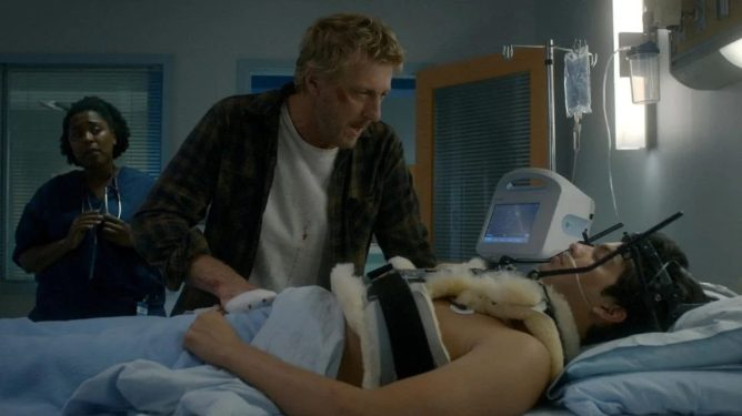 Williiam Zabka caring to Xolo Maridueña in a hospital bed as seen in season 3 of Cobra Kai.