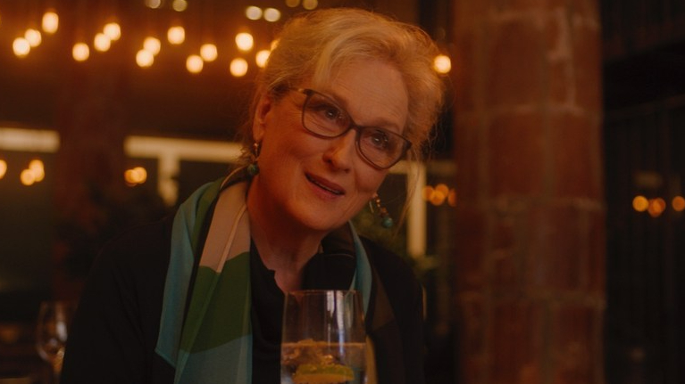 Meryl Streep sitting in a dim restaurant as seen in Let Them All Talk exclusive to HBO Max.