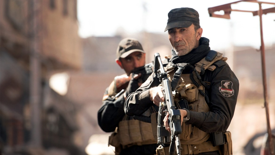 Qutaiba Abdelhaq as Kamal and Suhail Dabbach as Major Jaseem as seen in Mosul on Netflix.