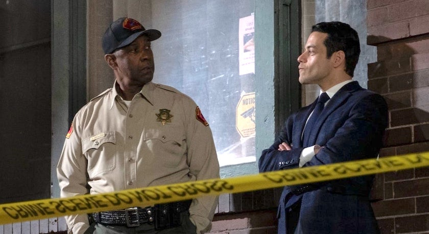 Denzel Washington and Rami Malek work together in a crime scene as seen in The Little Things.