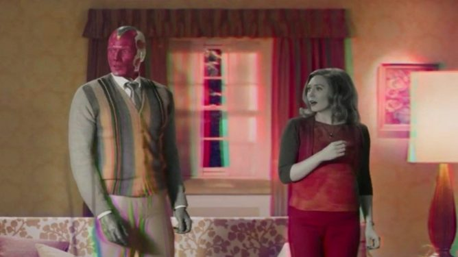 The Vision and Wanda Maximoff see their sitcom TV living room change from black-and-white to color as seen in WandaVision.