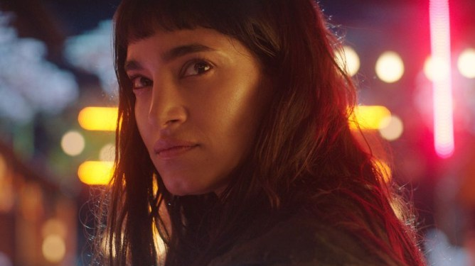 Sofia Boutella in the neon lit Samurai Town as seen in Prisoners of the Ghostland.