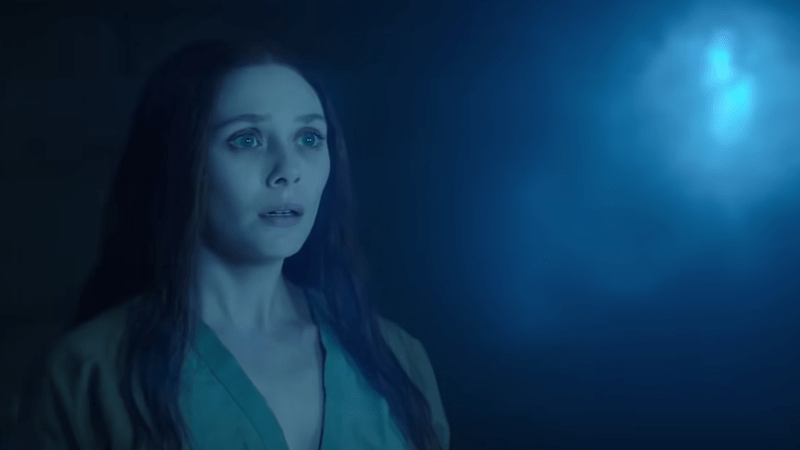 Wanda Maximoff looking at the Mind Infinity Stone as seen in episode 8 of WandaVision.