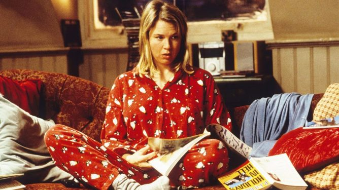 Renee Zellweger as Bridget Jones sitting reading in Bridget Jones' Diary