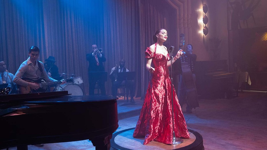 Andra Day singing in a jazz club wearing a beautiful red dress as seen in The United States vs. Billie Holiday.