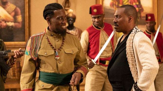 Wesley Snipes in a colorful general uniform next to Eddie Murphy in a royal robe as seen in Coming 2 America on Prime Video.