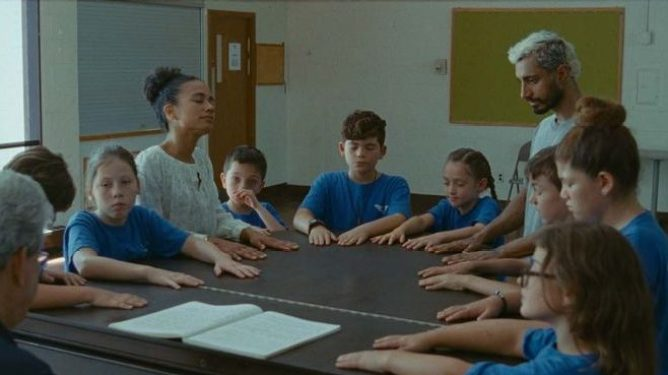 Riz Ahmed and Lauren Ridloff learning ASL with young students as seen in the Oscar nominated film Sound of Metal.