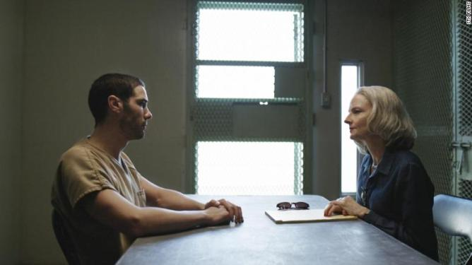 Tahar Rahim and Jodie Foster in a prison interrogation room as seen in The Mauritanian.