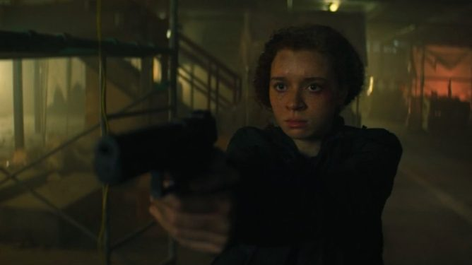 Erin Kellyman as Karli Morgenthau holding a gun during a stand off in the season finale of The Falcon and the Winter Soldier.