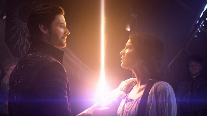 Ben Barnes as General Kirigan holding Jessie Mei Li as Alina Starkov as seen in Netflix's adaptation of Shadow and Bone.