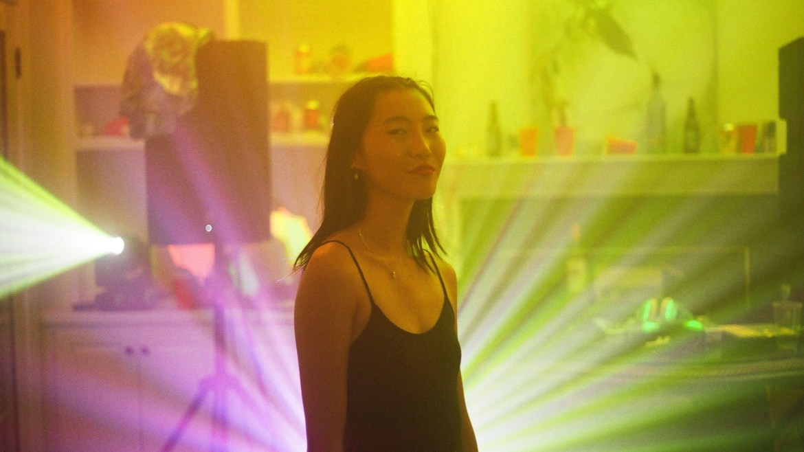 Shirley Chen as Krista in a dance room with yellow lights as seen in the new indie teen drama Beast Beast.