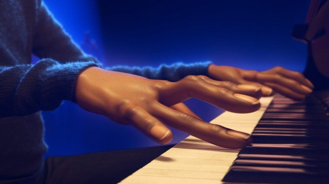 A close up of Joe Gardner voiced by Jamie Foxx playing the piano in a Jazz club as seen in the Pixar film Soul directed by Pete Docter.