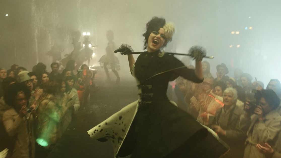 Emma Stone as Cruella rocking the runway in black and white spotted dress as seen in the new Disney live-action film.