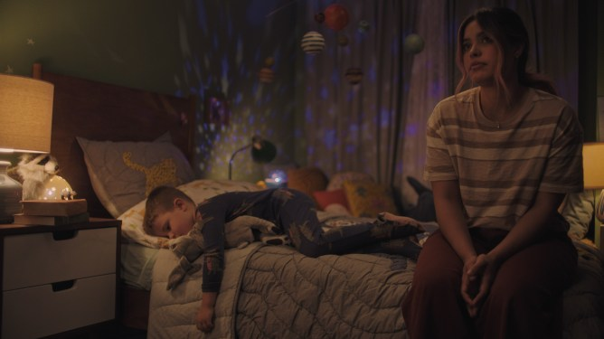 A young woman puts a 4-year-old to sleep as seen in the short Let's Be Tigers part of the Disney Launchpad program.