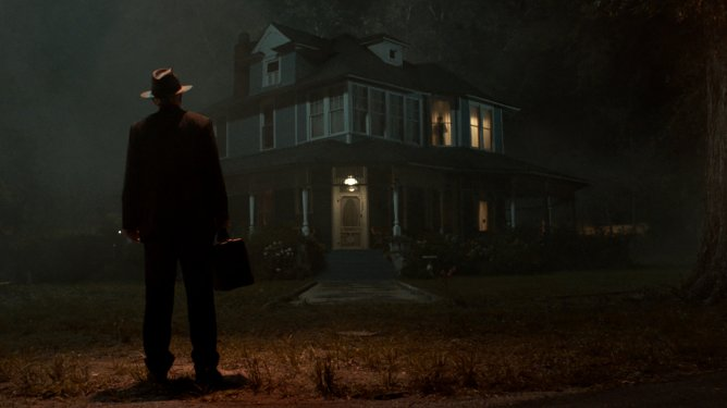 A haunted house and priest standing outside that resembles the iconic scene from The Exorcist as seen in The Conjuring: The Devil Made Me Do It