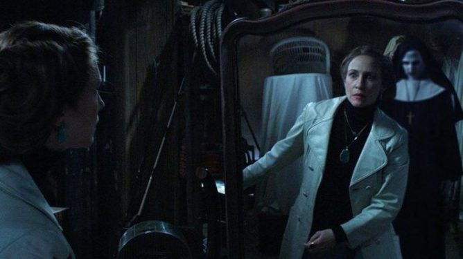Lorraine Warren comes face to face with Valak the demon nun in a mirror as seen in THE CONJURING 2, coming in at the very top spot in our Conjuring Universe ranking.