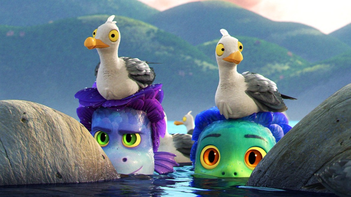 The sea monster kids hiding in the water with seagulls on their heads as seen in the latest Pixar film to hit Disney+ Luca.