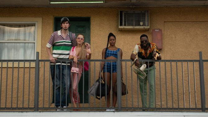 Nicholas Braun, Riley Keough, Taylour Paige, and Colman Domingo hanging out together on a balcony as seen in the latest A24 film ZOLA.