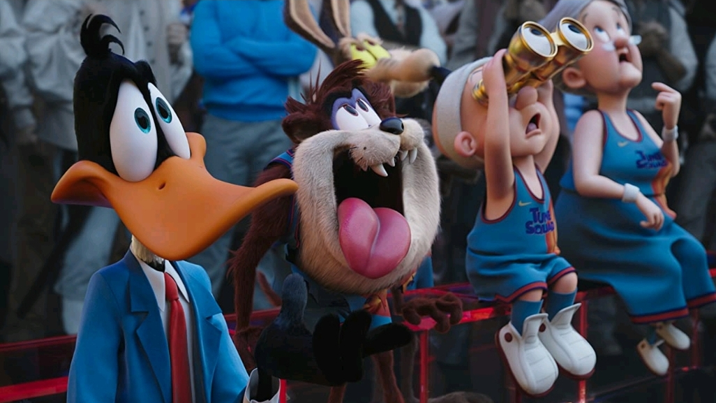 Daffy Duck, Taz, Elmer Fudd, and Granny watching the final basketball game from the bench as seen in SPACE JAM: A NEW LEGACY.