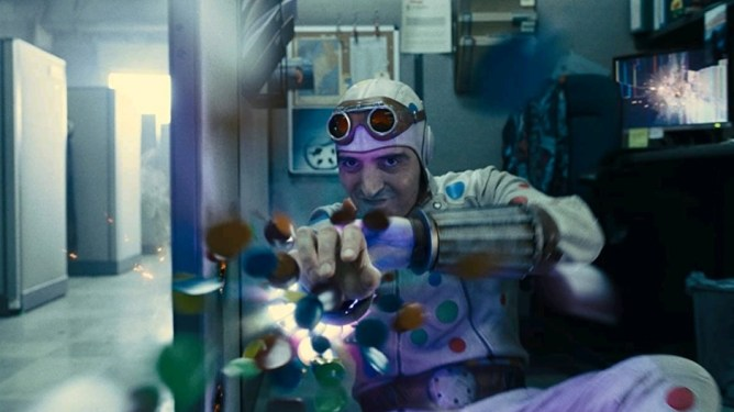 David Dastmalchian as Polka-Dot man shooting colorful explosive polka dots out of his arm as seen in THE SUICIDE SQUAD directed by James Gunn.