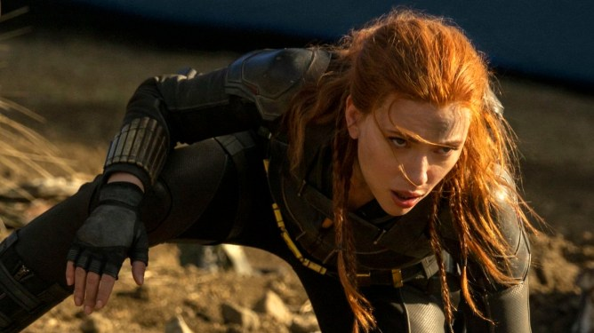 Scarlett Johansson as Natasha Romanoff posing in a battlefield as seen in the Marvel Studios' BLACK WIDOW, hitting theaters and Disney+.