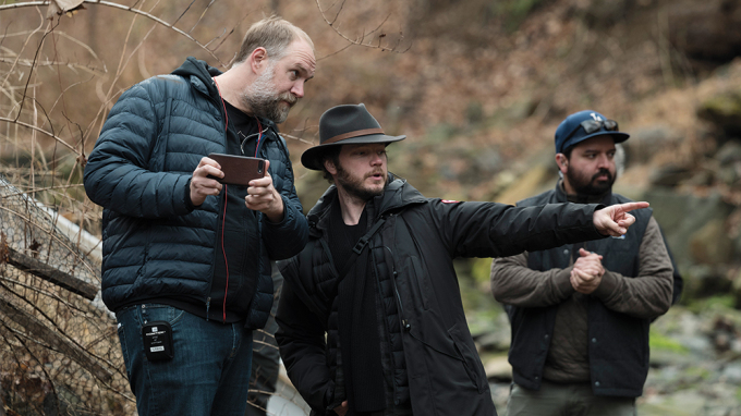Director Craig Zobel preps a scene by a river with cinematographer Ben Richardson on the set of the hit HBO limited series MARE OF EASTTOWN.