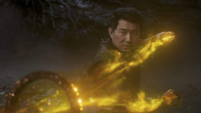 Simu Liu harnessing the golden energy of the ten rings in a fight against the mandarin as seen in the new marvel film SHANG-CHI AND THE LEGEND OF THE TEN RINGS.