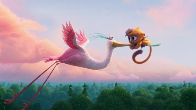 Vivo the yellow Kinkajou voiced by Lin-Manuel Miranda holding on to Dancarino the spoonbill voiced by Brian Tyree Henry as they fly in the sky as seen in the new Sony animated film on Netflix VIVO.