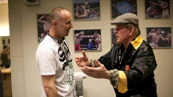 Director Gavin O'Connor blocks a scene with Nick Nolte in costume as an MMA coach on the set of WARRIOR, now celebrating its 10 year anniversary.