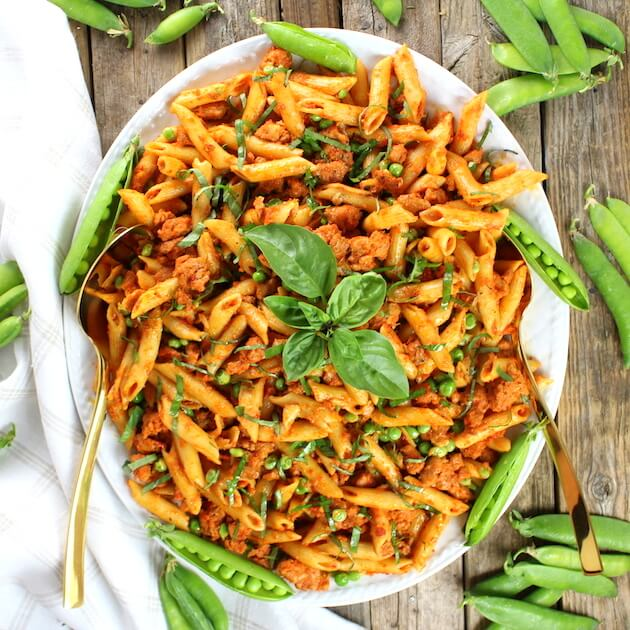 Spicy Chicken Pasta and Peas with Sun-Dried Tomato Sauce from Taste and See