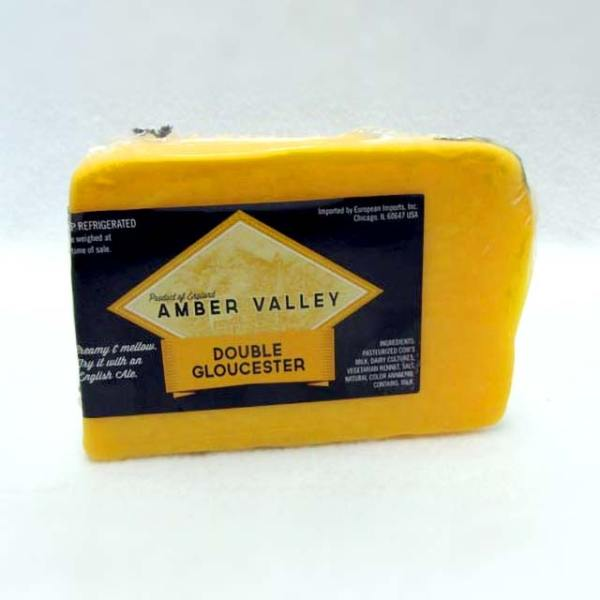 Wedge of Amber Valley Double Gloucester.