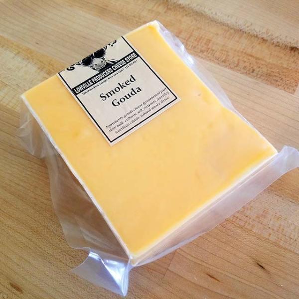 A brick of Smoked Gouda cheese.