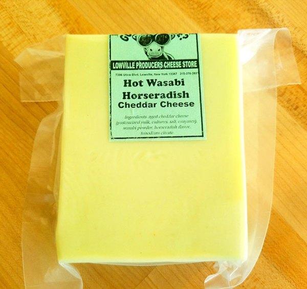 A brick of Hot Wasabi Horseradish Cheddar cheese.