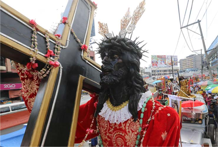 Milions on the street of Manila trying to touch the old statue of BLACK JESUS