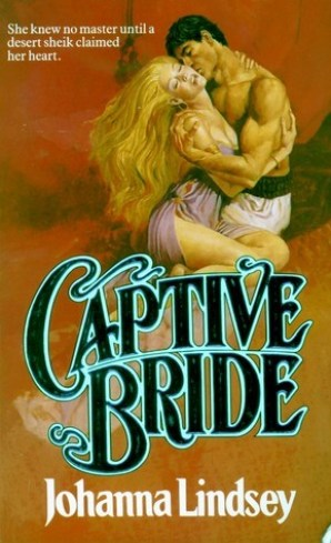 Book cover showing a very muscular shirtless man holding a very busty blonde woman. Text reads Captive Bride