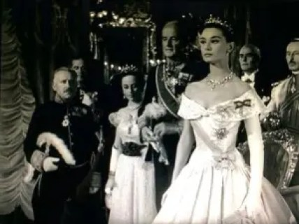 Audrey Hepburn in a formal gown and tiara in Roman Holiday