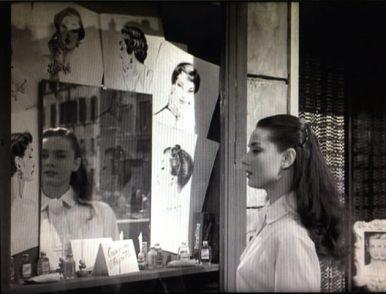 Audrey Hepburn looks into a salon window in Roman Holiday