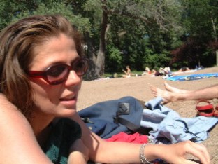 Face of a white woman lying on a beach