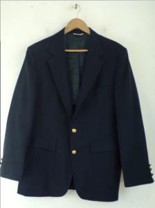 A navy blue blazer on a hanger