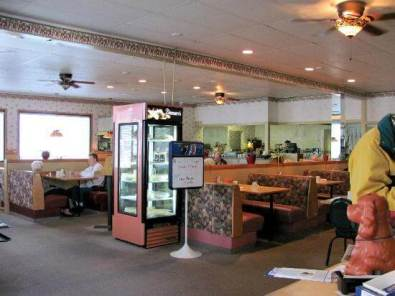 Interior of a diner with booths and a pie case.