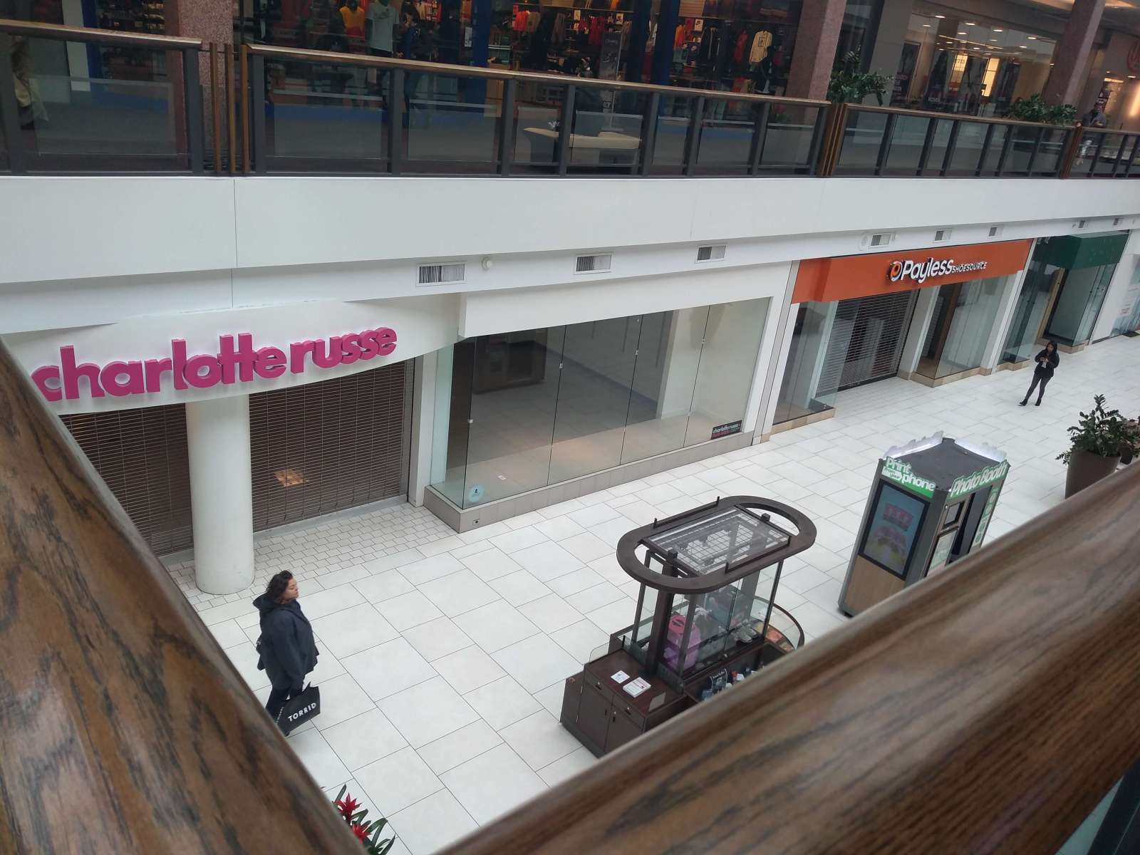 a row of empty mall stores including Charlotte Russe and Payless. Forever 21 might be next.