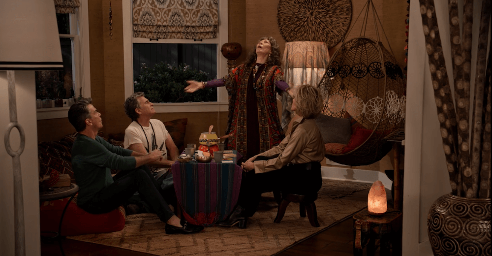 Lily Tomlin as Frankie leading a cacao ceremony in her living room
