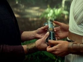 Close up of Leia handing Rey a lightsaber in Rise of Skywalker