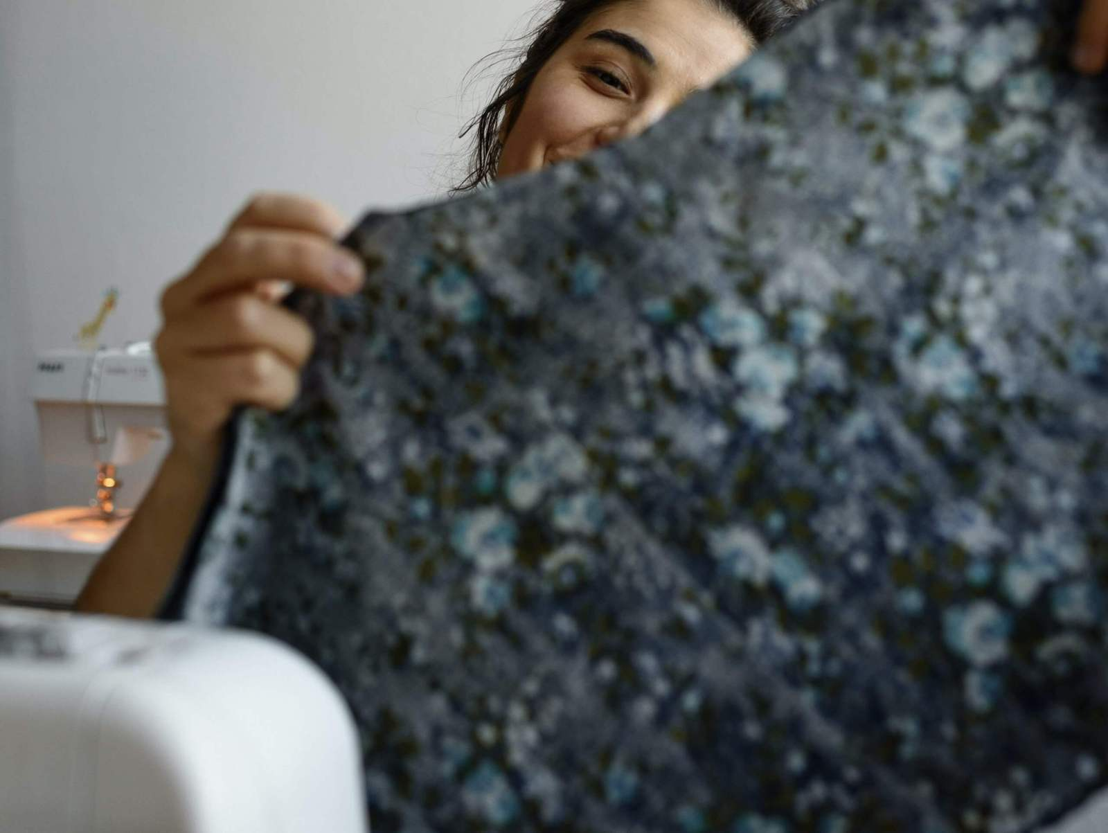 Upcycling woman holding blue fabric