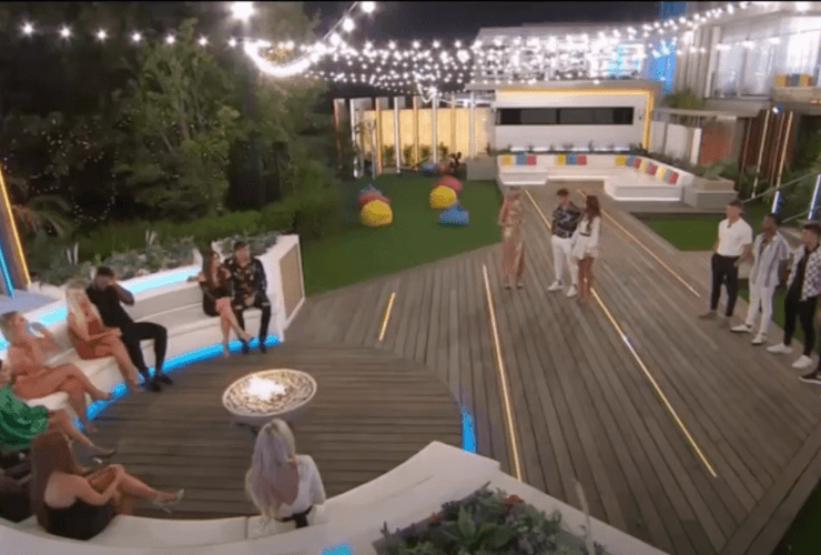 Love Island contestants on a big white couch