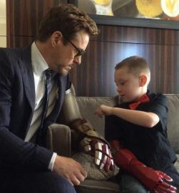 http://www.bleedingcool.com/2015/03/14/robert-downey-jr-delivers-bionic-arm-to-7-year-old-boy/