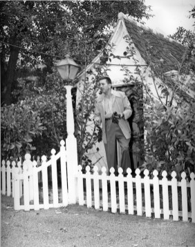 Walt in front of the cottage. via Glamour
