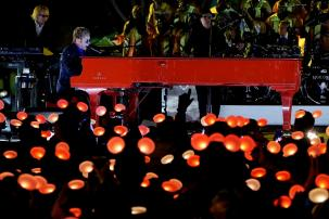 "Elton John performs on his million dollar red piano in front of Disneyland's Sleeping Beauty Castle for the ABC Television Special, ""The Wonderful World of Disney: Disneyland 60"" that will air February 21st at 8 p.m. (c) OC Register"