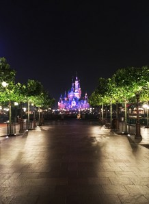 Nighttime view of Enchanted Storybook Castle & Gardens of Imagination